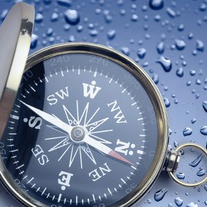 Compass with rain drops on it.