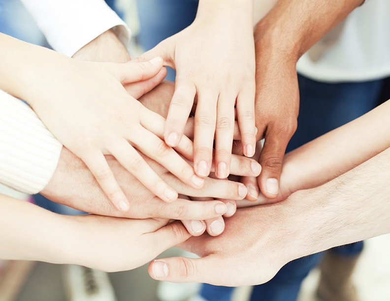 Many hands meeting together