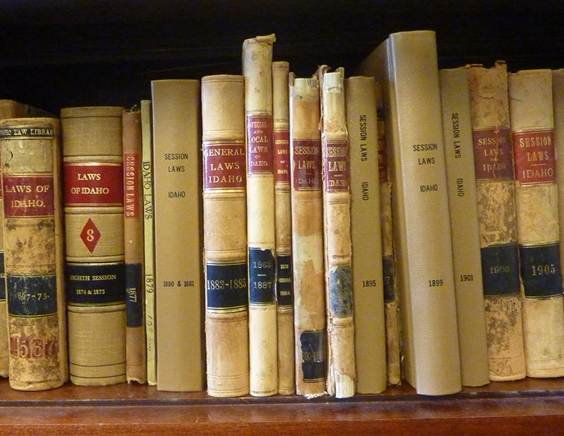 Old session law books in the Idaho legislative library.